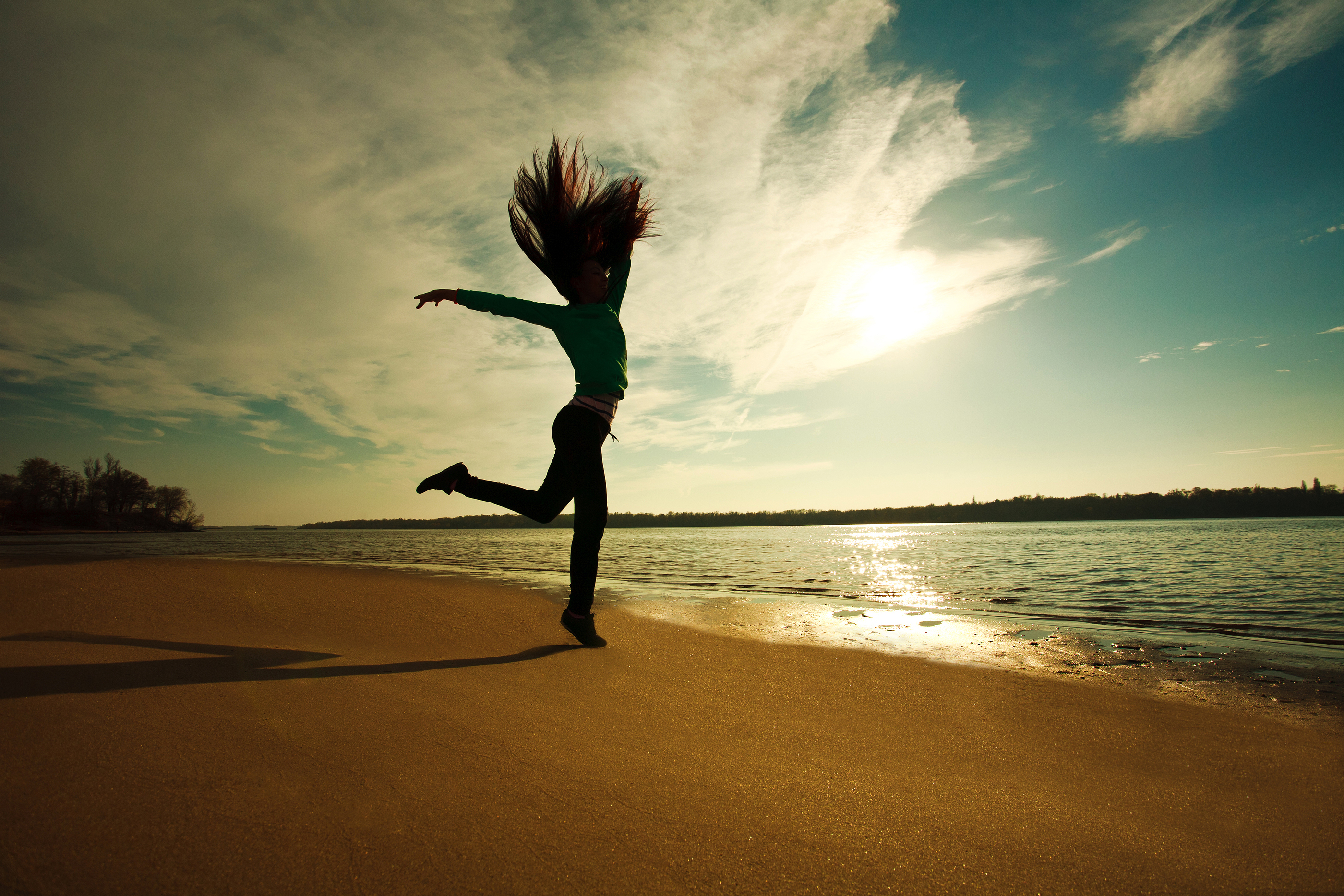 Power of Determination: Woman Jumping On The Beach On Sunny Sky Background, Freedom And