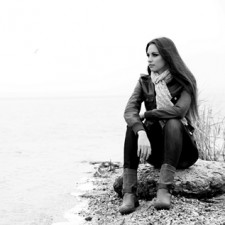 Manage Stress: Portrait of young serious woman near river